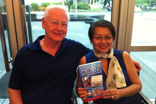 Carol Esguerra Colborn (right) holds her book as she poses for a photo with her husband, Bill Colborn | Photo: Abs-Cbnnews.com